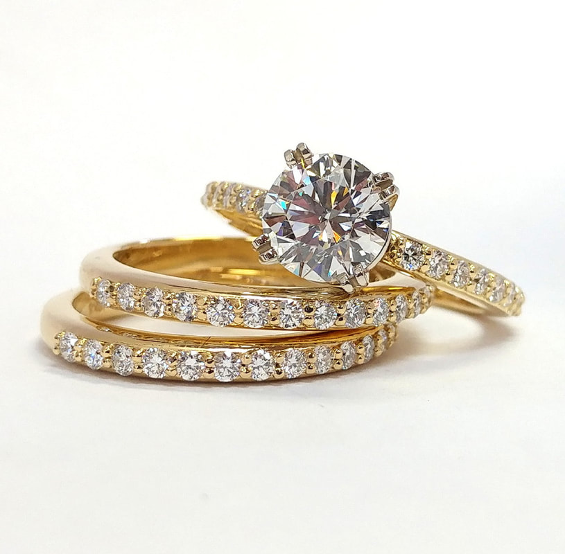 Wedding set featuring 14k yellow gold and bezel set Cognac diamonds